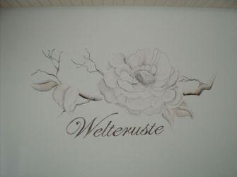 Rik-Muurschilderingen-Muurtekst-met-bloem