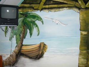 muurschildering boot strand