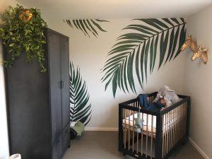 Muurschildering palmbladeren
